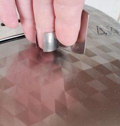 Protetor Dedal Cozinha  (Prata 6.5 x 4.8 x 2 cm) photo review